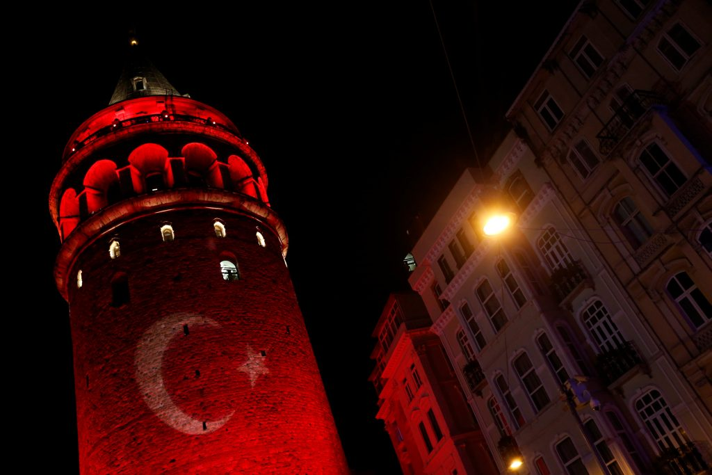 A Turkish flag is projected on the historical Galata Tower in tribute to the victims of Saturday's blasts, in Istanbul, Turkey, early December 12, 2016. REUTERS/Murad Sezer