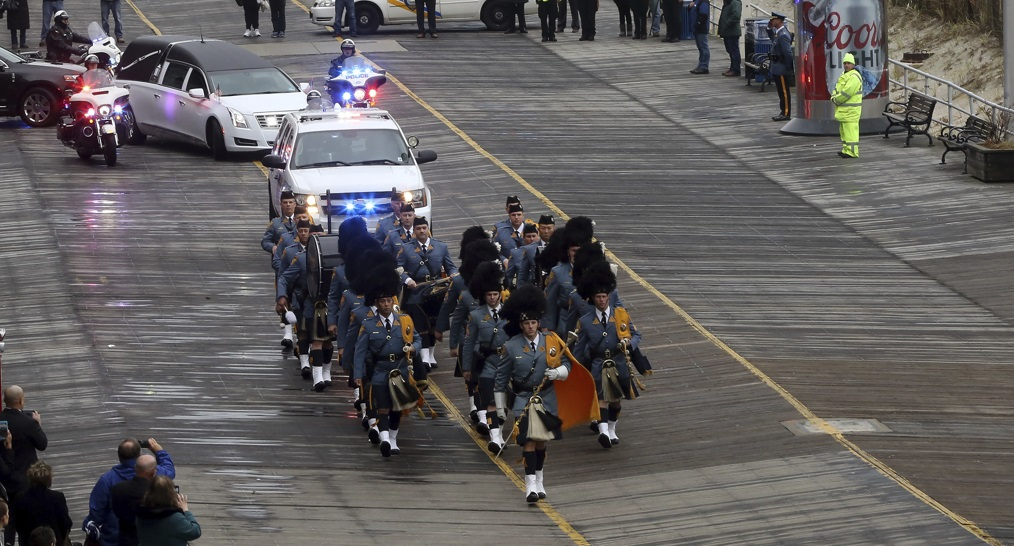 The funeral procession for fallen NJ State Trooper Frankie Williams on Monday passes by Boardwalk Hall in Atlantic City. (Dale Gerhard/The Press of Atlantic City via AP)