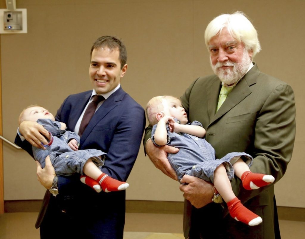 Dr. Oren Tepper (L) and Dr. James Goodrich holding a pair of formerly conjoined twins, Jadon, left and Anias in Montefiore Medical Center in the Bronx. (Montefiore Hospital via AP)