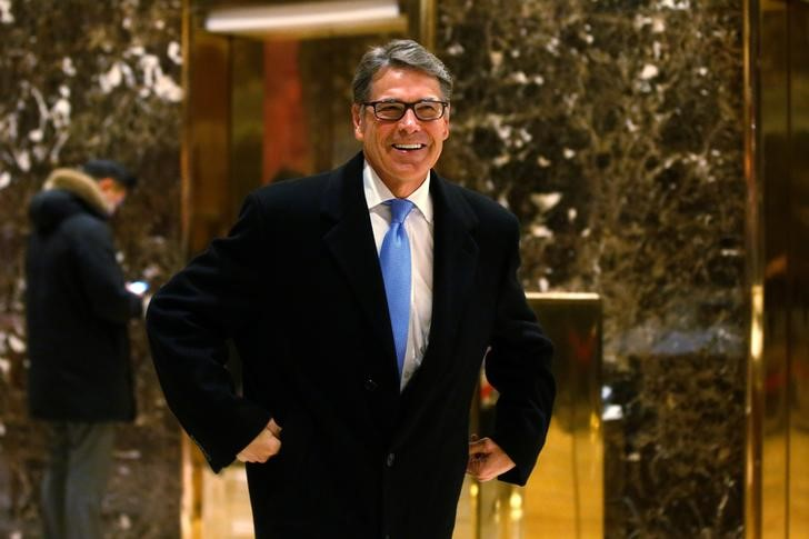 Former Texas Governor Rick Perry exits after meeting with U.S. President-elect Donald Trump at Trump Tower in Manhattan, New York City, U.S., December 12, 2016. REUTERS/Brendan McDermid