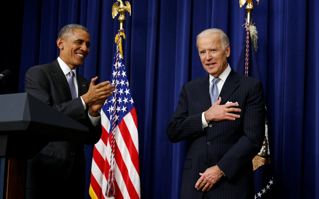 Vice President Joe Biden puts his hand to his heart after President Barack Obama called Biden the greatest vice president in history during a signing ceremony for the 21st Century Cures Act at the White House on Tuesday. (Reuters/Kevin Lamarque)