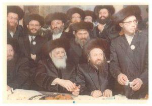 "Reb Moshe Chanoch, z""l, standing between Bobover Rebbes, Harav Shlomo, zy""a, and Harav Naftule Tzvi, zy""a."
