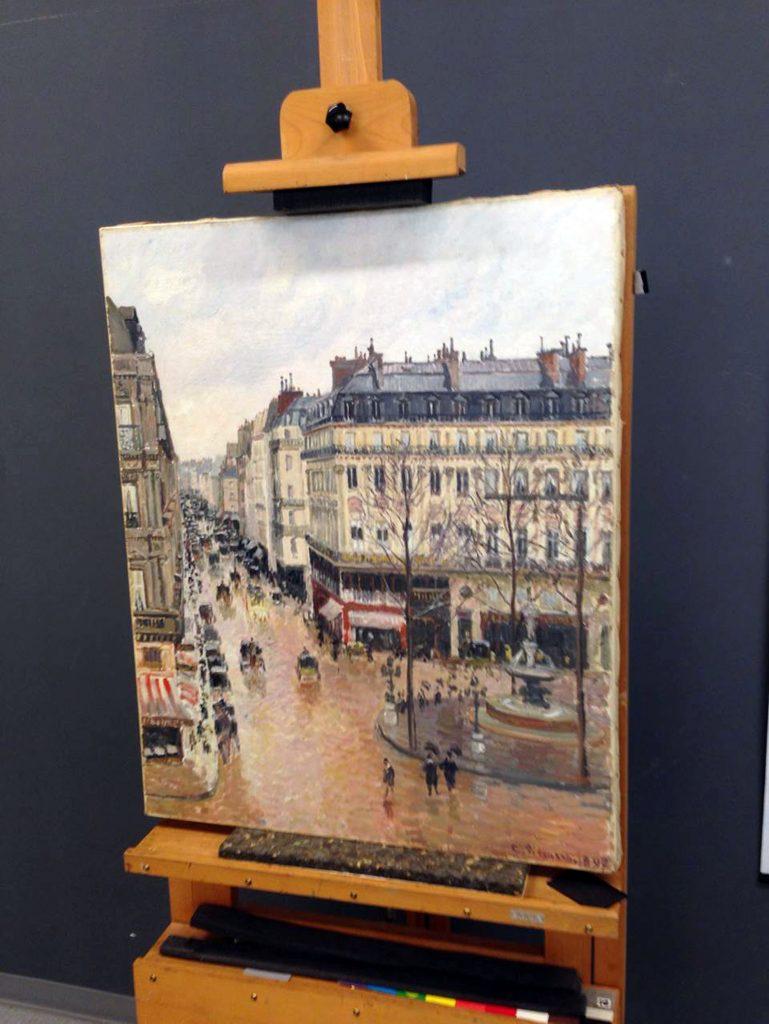"""Camille Pissarro's 1897 Impressionist masterpiece, """"Rue Saint-Honoré, dans l'après-midi. Effet de pluie,"""" at the Museo Thyssen-Bornemisza in Madrid. (Jonathan Petropolous via AP)"""