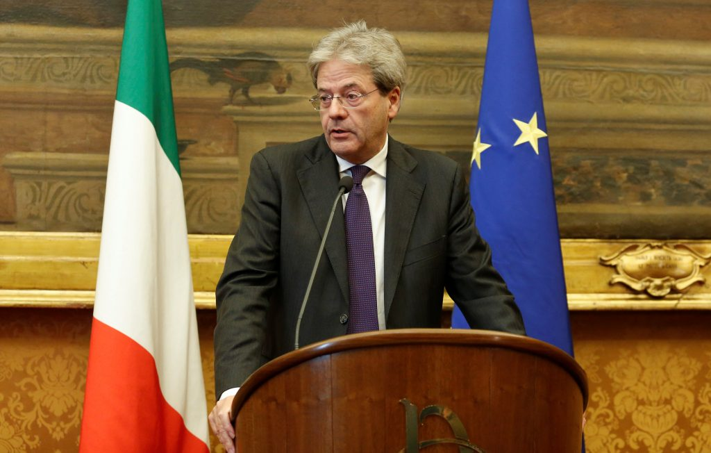 Italian Prime Minister-designate Paolo Gentiloni speaks to journalists at the end of a meeting in the Low Chamber in Rome on Monday. (Reuters/Remo Casilli)