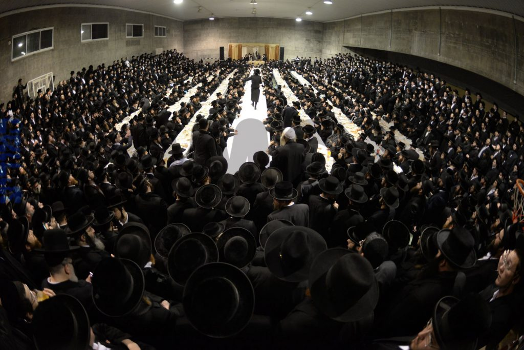 Harav Elimelech Biderman leads the tefillos at the kever. (JDN)