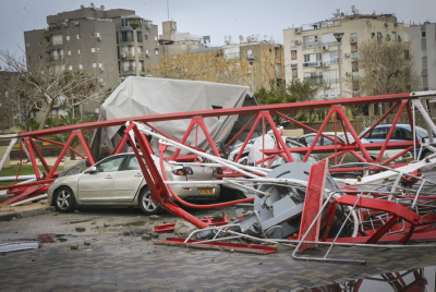 View of the crane that collapsed on a number of cars parked on a street in Bat Yam on Feb. 14