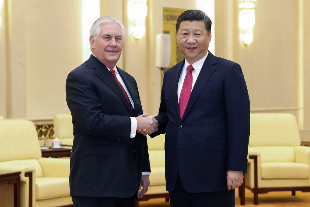 U.S. Secretary of State Rex Tillerson, left, shakes hands with China's President Xi Jinping