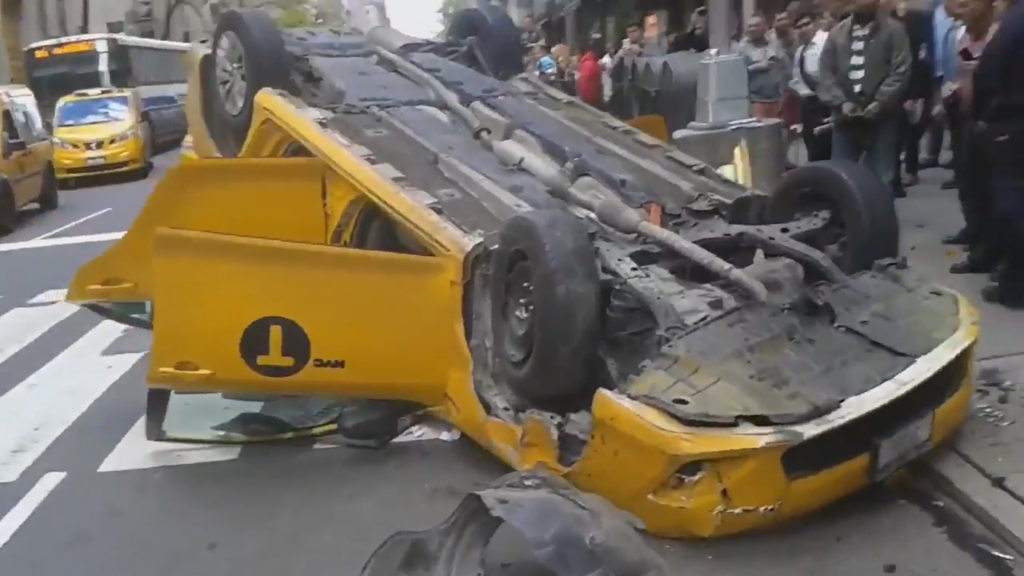Hurt, Taxi, Flips Over, Midtown Manhattan