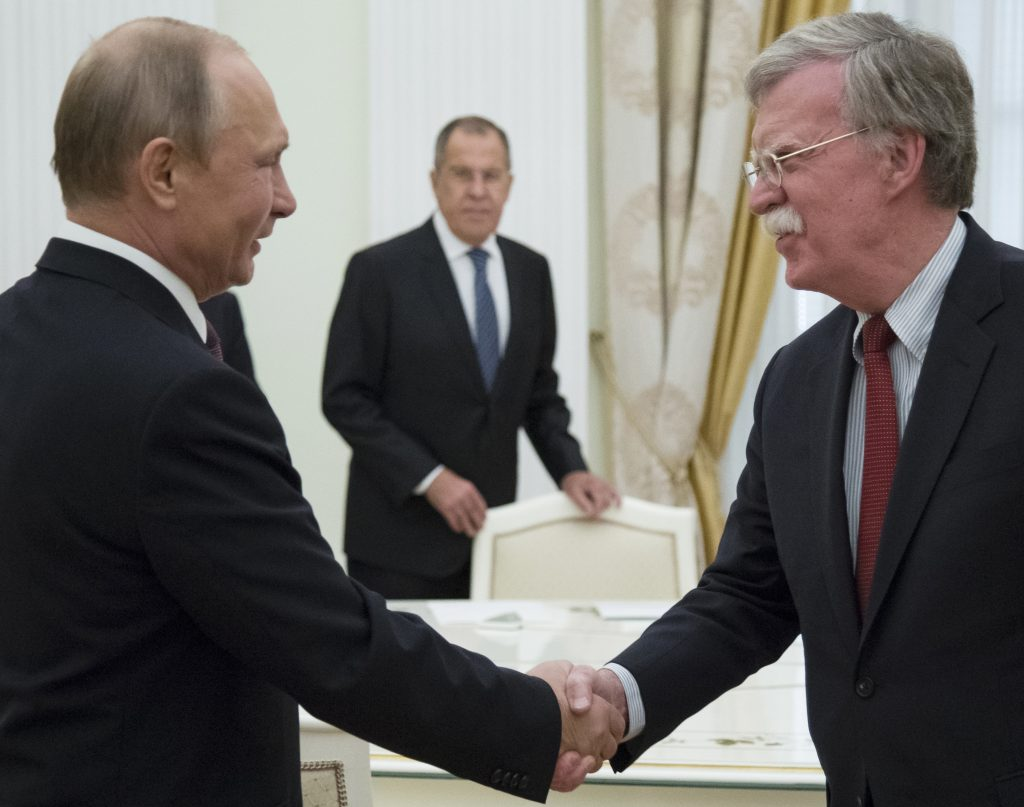 Putin trump to have summit in helsinki on july 16 jewish news russian president vladimir putin l and us national security adviser john bolton greet each other as russian foreign minister sergey lavrov c looks on m4hsunfo