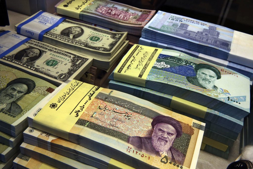 Iranian And U S Banknotes Are On Display At A Currency Exchange In Downtown Tehran Iran Ap Photo Vahid Mi File
