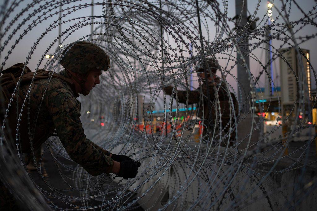 troops migrants